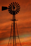 Windmill Fire clouds. Old windmill with dramatic clouds Stock Photography