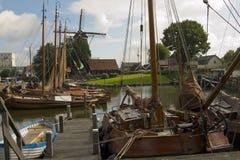 Windmill and Fishing boats Royalty Free Stock Photos