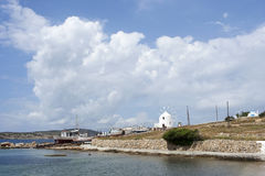 Windmill and fishing boats in Koufonissi island Stock Photography