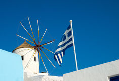 Windmill and flag Stock Photography