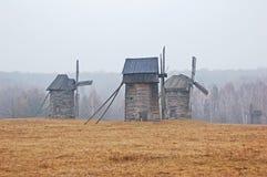 Windmill in fog Stock Photo