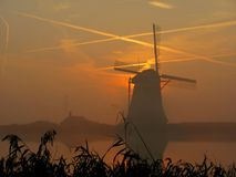 Windmill fog Stock Photo