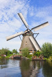 Windmill Garden Party. Discreet Windmill Garden Party at the border of the canal royalty free stock photos