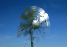 Windmill generating power. Against a clear blue sky Stock Images
