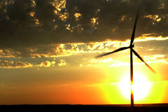 Windmill for Generating Power Wind Blowing Sky Clouds Sunset Sun Stock Photos