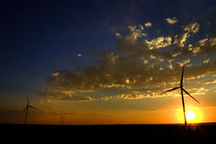 Windmill for Generating Power Wind Blowing Sky Clouds Sunset Sun Stock Image