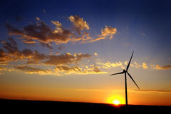Windmill for Generating Power Wind Blowing Sky Clouds Sunset Sun Stock Photography