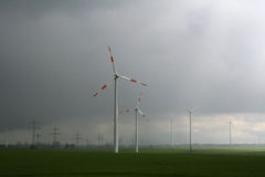 Windmill generator in wide yard. Yard of windmill power generatorunder blue sky, shown as energy industry concept Stock Photo