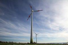Windmill generator in wide yard Royalty Free Stock Photos