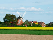 Windmill in german spring landscape. Litle village in west germany with windmill in spring Royalty Free Stock Image