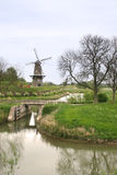 Windmill of Gorinchem. Windmill and waterway of Gorinchem Holland surrounded by trees and green grass stock images