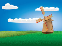 Windmill on grass field Royalty Free Stock Image