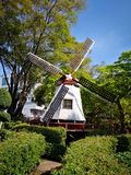 A small windmill beside the Melaka river. Travel Asia Malaysia tourism. Sky is blue and the nice weather royalty free stock photo