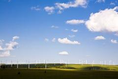 Windmill in the grassland Stock Photo