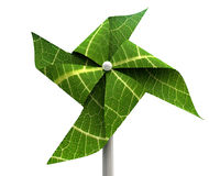 Windmill Green Energy. A green windmill made out of leaves isolated on a white background Royalty Free Stock Images