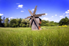 Windmill on green field Royalty Free Stock Photo