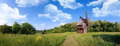 Windmill on green field stock photos