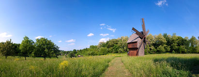 Windmill on green field Stock Photography