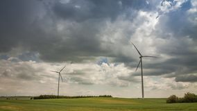 Windmill on green field in summer on a sunny day, timelapse stock video footage