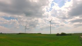 Windmill on green field in sunny summer day stock video
