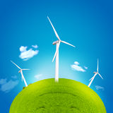 Windmill and green globe Royalty Free Stock Photo