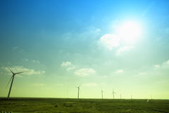 Windmill in green grassland Royalty Free Stock Photography