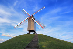Windmill on green hill in Bruges Royalty Free Stock Images