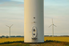 Windmill, group of aligned windmills for electric power generation alternative Stock Photo