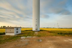 Windmill, group of aligned windmills for electric power generation alternative Stock Images