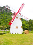 Windmill, Hay Roll, Green Grass Field And Canal. Stock Photos
