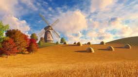Windmill and haystacks on autumn fields Royalty Free Stock Photo