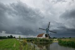 Windmill in Hazerswoude, Holland under stormy sky stock images