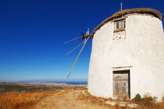 Windmill on a hill in Greece Stock Photography
