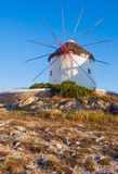 Windmill on a hill near the sea on the island of Mykonos Stock Images