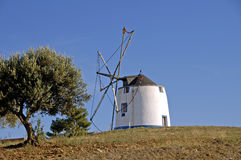 Windmill on a hill Stock Photos