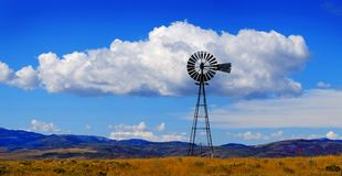 Windmill on Hillside in Countryside Rural America with Sky and C. Louds Royalty Free Stock Photo