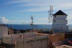 Windmill in historical area in old town stock photos