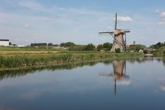 Windmill Holland. The small bridge inverted image in water of Holland windmill Royalty Free Stock Photo