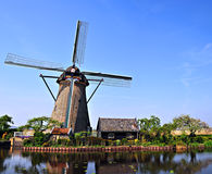 Windmill Holland. Windmill on the background the blue sky in Kinderdijk, Holland Royalty Free Stock Images