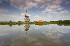 Windmill in holland. Windmill in Kinderdijk - Holland. Shot with wide angle and sky filter Royalty Free Stock Image