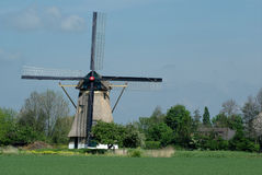 Windmill of Holland. On green grass stock photos