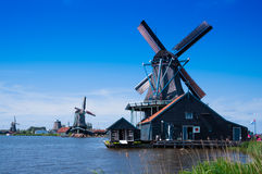 Windmill in holland. With blue sky Stock Photo