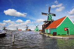 Windmill in Holland with canal Royalty Free Stock Image