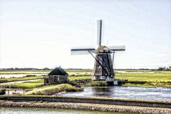 Windmill in Holland. A windmill is a machine that converts the energy of wind into rotational energy by means of vanes called sails or blades Royalty Free Stock Images