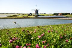 Windmill in Holland. A windmill is a machine that converts the energy of wind into rotational energy by means of vanes called sails or blades Royalty Free Stock Image