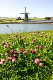 Windmill in Holland. A windmill is a machine that converts the energy of wind into rotational energy by means of vanes called sails or blades Stock Photography