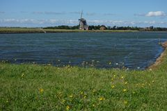 Windmill in Holland. A windmill is a machine that converts the energy of wind into rotational energy by means of vanes called sails or blades Royalty Free Stock Photography