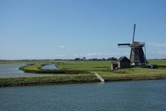 Windmill in Holland. A windmill is a machine that converts the energy of wind into rotational energy by means of vanes called sails or blades Stock Images
