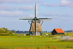 Windmill in Holland. A windmill is a mill that converts the energy of wind into rotational energy by means of vanes called sails or blades Royalty Free Stock Image