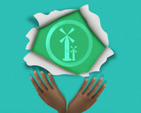 Windmill icon symbol found under torn yellow paper with hands. Illustration on blue Royalty Free Stock Image